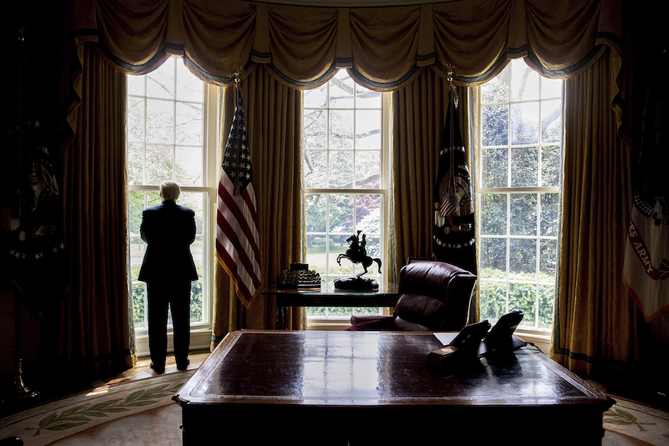 President Donald Trump looks out an Oval Office window at the White House in Washington following an interview with The Associated Press, April 21. Health care is complicated. China can be a useful ally. NATO is not obsolete. Being president is hard. Over the course of his 100 days in office, President Donald Trump has been startlingly candid about his public education in the ways of Washington and the world. (AP Photo/Andrew Harnik)