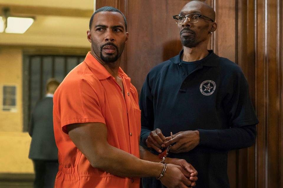 "This image released by Starz shows Omari Hardwick, left, with Charlie Murphy in a scene from the original series, ""Power."""