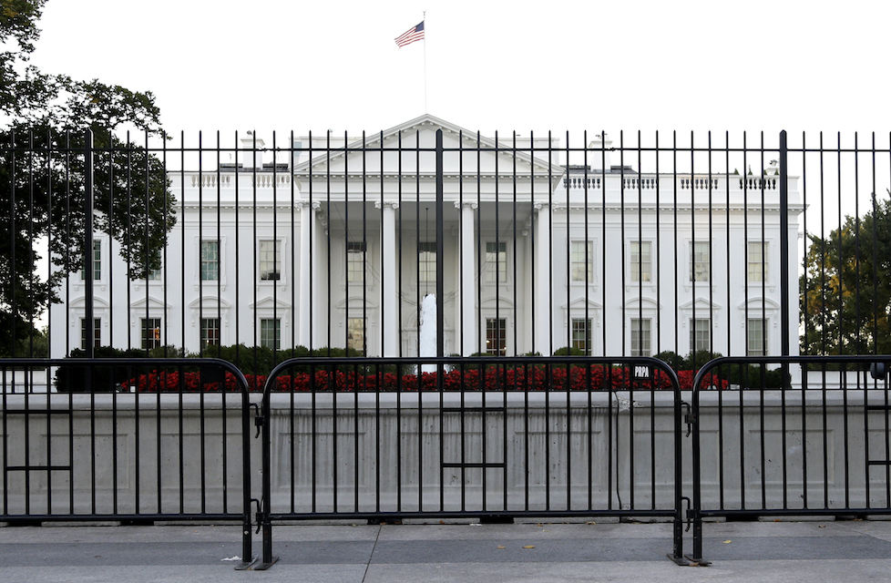 The perimeter fence sits in front of the White House fence on the North Lawn along Pennsylvania Avenue in Washington,Sept 22,2014. Their reputations at risk, a coterie of President Donald Trump's associates caught up in the swirling debate about Trump and Russia are turning to a similar if unusual playbook: volunteering to testify to Congress, before even being asked. (AP Photo/Carolyn Kaster, File)