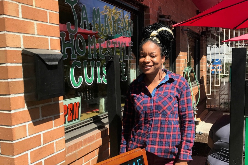 Keacean Phillips in front of Jamaican Homestyle Cuisine