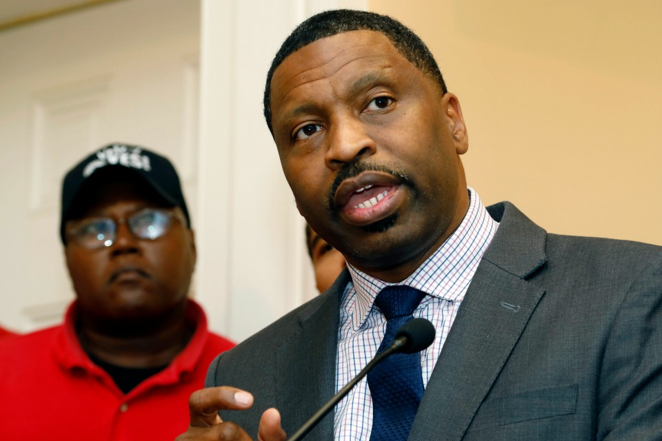NAACP Interim president and CEO Derrick Johnson, right, in Canton, Miss. during a Monday, July 31, 2017 news conference in Jackson. (AP Photo/Rogelio V. Solis)