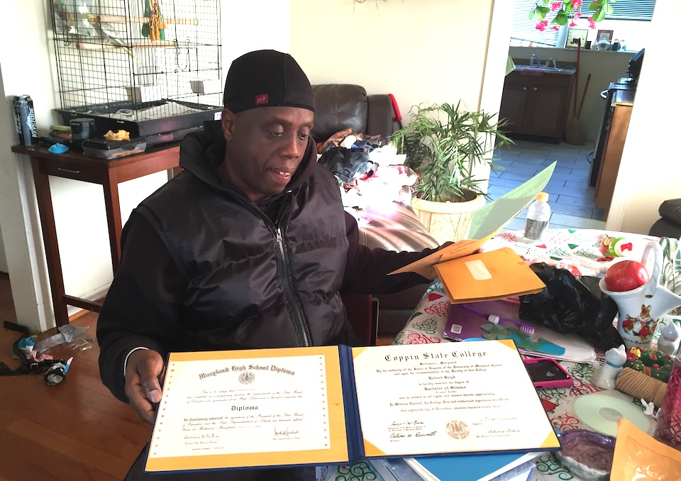 "Robert Boyd holds high school and college diplomas he earned while incarcerated, at his home in Baltimore, Dec. 28, 2016. At 16, he was sentenced to life for his role in a home invasion that turned deadly in Baltimore. Boyd was the lookout, standing watch on the porch. The man who fired the fatal shot was acquitted at trial. By the time Boyd was released, after 34 years behind bars, even Brian Murphy, the prosecutor who tried the case in 1982, offered to testify on his behalf. ""It was not the intention of anybody back then that guys like this wouldn't get paroled,"" Murphy said. ""It doesn't sound fair or legal."" (AP Photo/Juliet Linderman)"