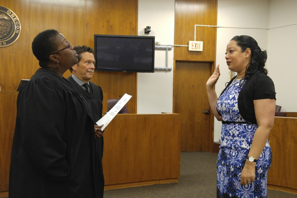 On Tuesday, Aug. 1, Judge Adrienne Nelson (left), of Multnomah County Circuit Court, swears in Ulanda Watkins (right) as judge of Clackamas County Circuit Court. Presiding Judge Robert D. Herndon looks on (center). (Melanie Sevcenko)
