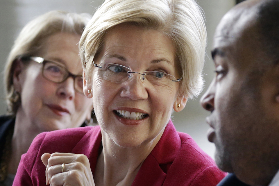 Sen. Elizabeth Warren, D-Mass., center, smiles during a small business roundtable discussion in Lawrence, Mass., March 3, 2017. At left is Rep. Niki Tsongas, D-Mass., and at right is Lawrence Mayor Daniel Rivera. The Senator won't face re-election until November2018, but two Republicans have announced their candidacies, two others are said to be weighing runs and conservative political groups are chipping away at the candidate. Still, Warren enjoys enormous advantages, including a national base of support, a fat campaign account and solid poll numbers. (AP Photo/Elise Amendola, File)
