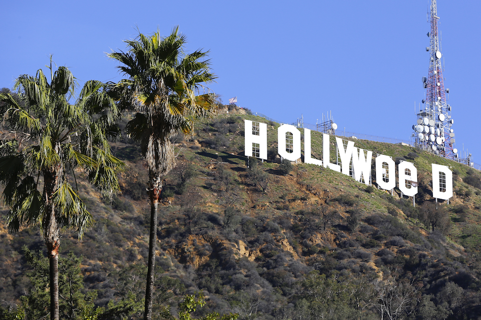 "The Hollywood sign is seen vandalized, Jan. 1, 2017. Los Angeles residents awoke New Year's Day to find a prankster had altered the famed Hollywood sign to read ""HOLLYWeeD."" California on Monday, Jan. 1, 2018, becomes the nation's largest state to offer legal recreational marijuana sales. In general, the state will treat cannabis like alcohol, allowing people 21 and older to possess up to an ounce of pot and grow six marijuana plants at home. Voters approved legalization in 2016. (AP Photo/Damian Dovarganes, File)"