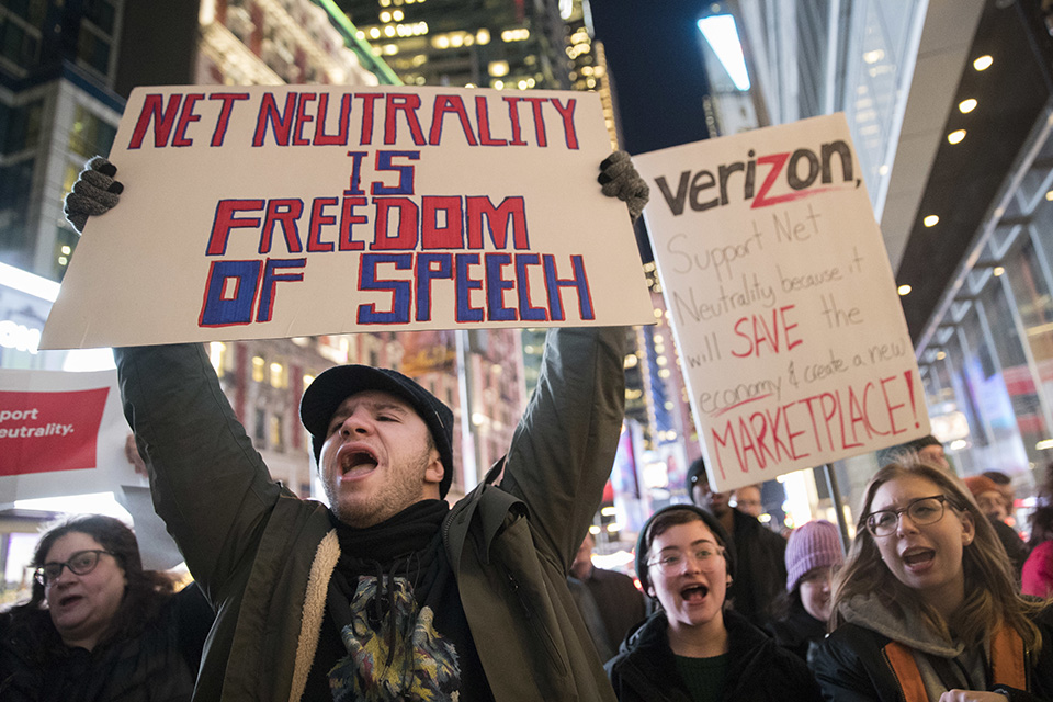 "In this Dec. 7 file photo, demonstrators rally in support of net neutrality outside a Verizon store in New York. The Federal Communications Commission is voting Thursday, Dec. 14 to undo Obama-era ""net neutrality"" rules that guaranteed equal access to the internet. The industry promises that the internet experience isn't going to change, but the issue has struck a nerve. Protests have erupted online and in the streets as everyday Americans worry that companies like Comcast, Verizon and AT&T will be able to control what they see and do online. (AP Photo/Mary Altaffer, File)"