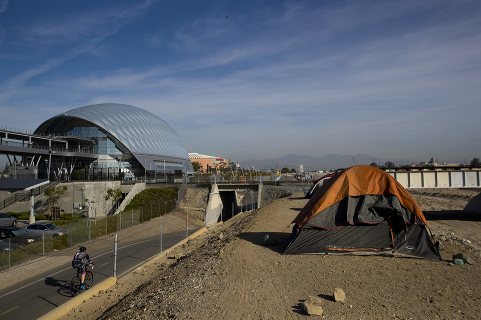 Homeless tents are pitched on the Santa Ana River trail near the Anaheim Regional Transportation Intermodal Center, a $185-million transportation center, Saturday, Dec. 2, 2017, in Anaheim, Calif. The number of homeless living in Orange County has climbed 8 percent over the last two years. In the United States, homelessness rose slightly in the last year to nearly 554,000, pushed up largely by increases on the West Coast, federal data shows. (AP Photo/Jae C. Hong)