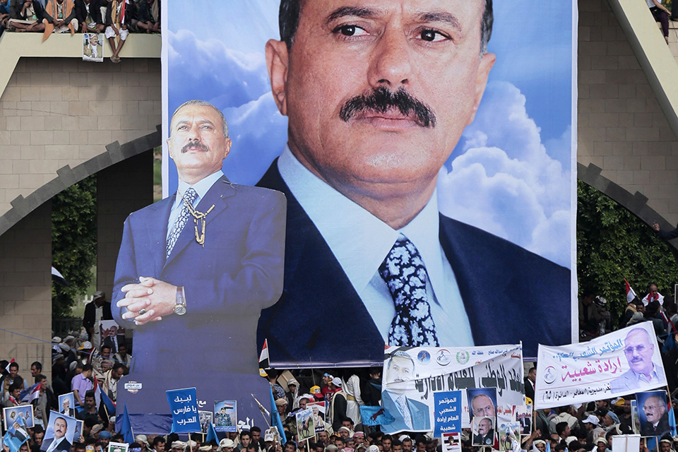 "In this Aug. 24, 2017 file photo, supporters of former Yemeni President Ali Abdullah Saleh attend a ceremony to celebrate the 35th anniversary of the founding of the Popular Conference Party, in Sanaa, Yemen, Aug. 24, 2017. Yemenis in the war-torn country's capital crowded into basements overnight, Monday Dec. 4, 2017, as Saudi-led fighter jets pounded the positions of Houthi rebels, who are now fighting forces loyal to Saleh for control of the city. A Sanaa-based protection and advocacy adviser for the Norwegian Refugee Council said Monday that the violence left aid workers trapped inside their homes and was ""completely paralyzing humanitarian operations."" (AP Photo/Hani Mohammed, File)"