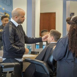 Champions Barbering Institute owner, Jamaal Lane, left. (Photo courtesy of CBI)