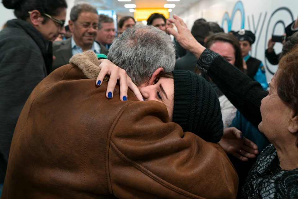 family members who have just arrived from Syria embrace and are greeted by family who live in the United States upon their arrival at John F. Kennedy International Airport in New York