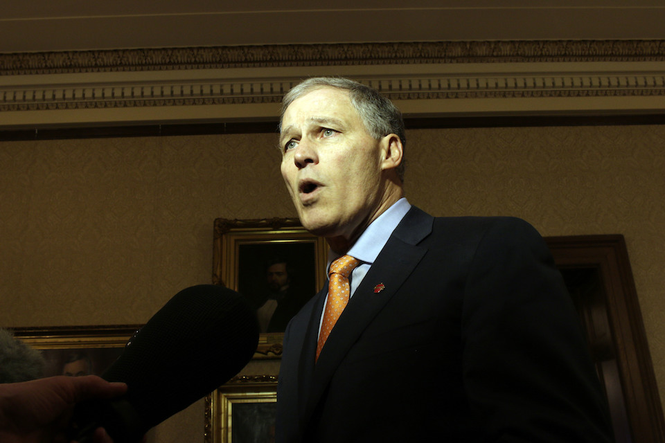 Washington Gov. Jay Inslee talks to reporters following a federal appeals court's refusal to reinstate President Donald Trump's travel ban on Thursday, Feb. 9, 2017, in Olympia, Wash. Inslee called the decision a victory for both the state and the nation. (AP Photo/Rachel La Corte)