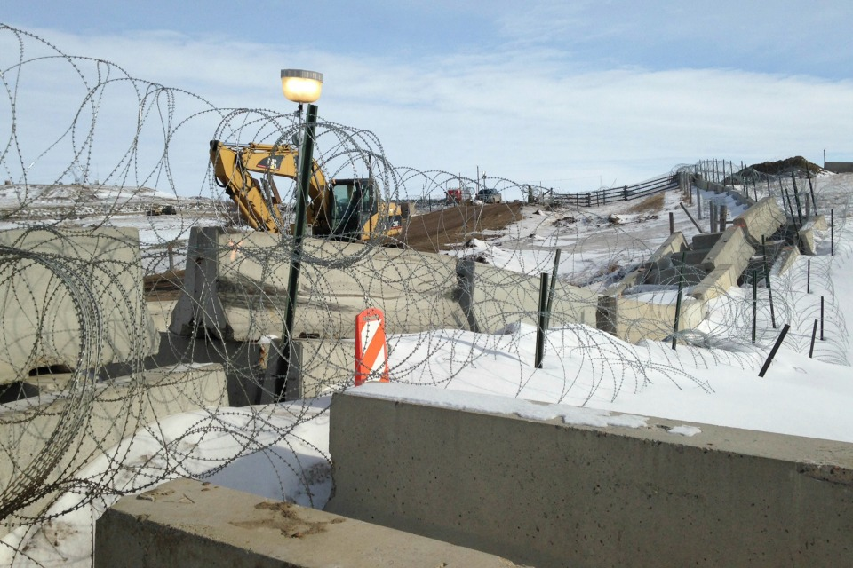 Razor wire and concrete barriers protect access to the Dakota Access pipeline drilling site Thursday, Feb. 9, 2017 near Cannon Ball, North Dakota. (AP Photo/James MacPherson)