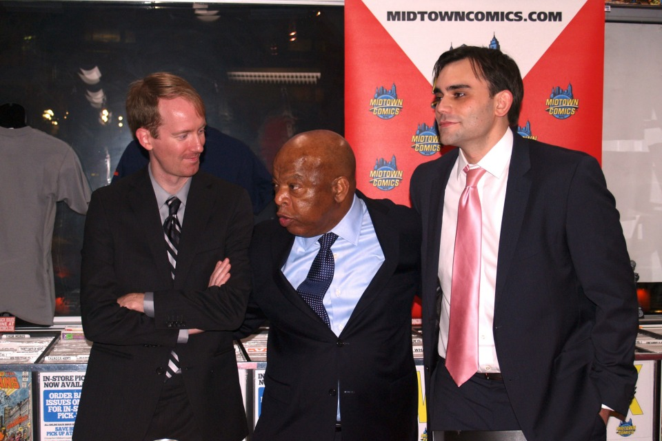 From left to right, comics artist and musician Nate Powell, civil rights leader and politician John Lewis and Lewis' telecommunications and technology policy aide Andrew Aydin, at a November 7, 2013 book signing for March Book One, the first volume of Lewis' three-volume graphic novel autobiography, at Midtown Comics Downtown in Manhattan. (Photo: © Luigi Novi / Wikimedia Commons)