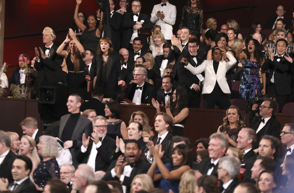 "In a stunning turnaround the cast of ""Moonlight"" hears that ""Moonlight"" has won the best picture award at the Oscars after the wrong picture was named in error on Sunday, Feb. 26, 2017, at the Dolby Theatre in Los Angeles. (Photo by Matt Sayles/Invision/AP)"