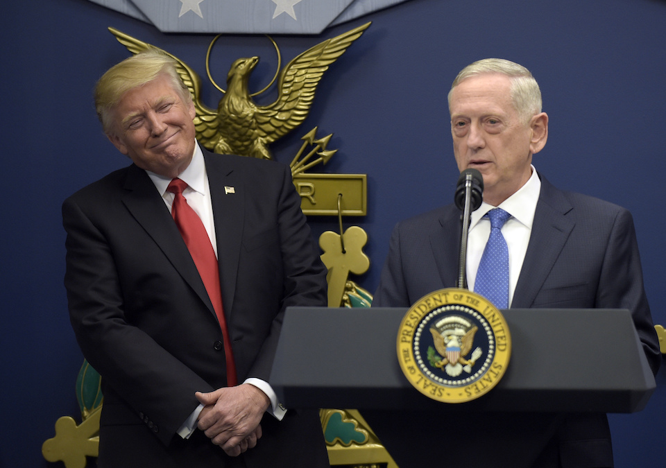 President Donald Trump, left, listens as Defense Secretary James Mattis, right, speaks at the Pentagon in Washington, Jan 27 2017. With Republicans in charge of Congress, President Donald Trump's pledge to boost the Pentagon's budget by tens of billions of dollars should be a sure bet. It's not. (AP Photo/Susan Walsh)