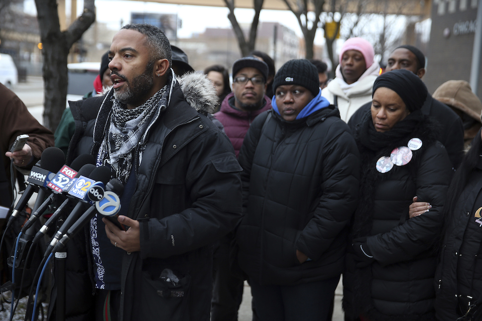 Kofi Ademola, left, of the group Black Lives Matter Chicago, and other protesters talk to the media outside the Chicago Police District 1 headquarters on South State Street in Chicago on Friday, Jan. 13, 2017. Speakers were critical of the mayor and the police department and said Chicagoans already knew from experience what the Department of Justice said in its report critical of the Chicago Police department. (Terrence Antonio James/Chicago Tribune via AP)
