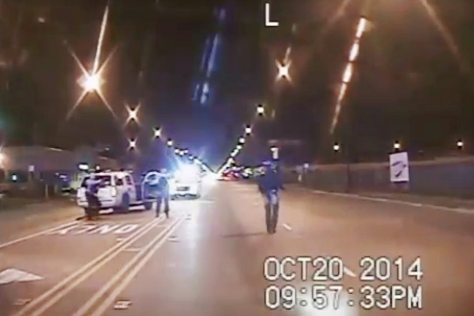In this Oct. 20, 2014 frame from dash-cam video provided by the Chicago Police Department, Laquan McDonald, right, walks down the street moments before being fatally shot by CPD officer Jason Van Dyke sixteen times in Chicago. (Chicago Police Department via AP File)