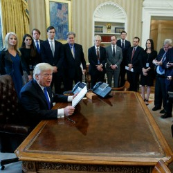 President Donald Trump talks with reporters in the Oval Office of the White House in Washington, Tuesday, Jan. 24, 2017, before signing an executive order on the Dakota Access pipeline. (AP Photo/Evan Vucci)