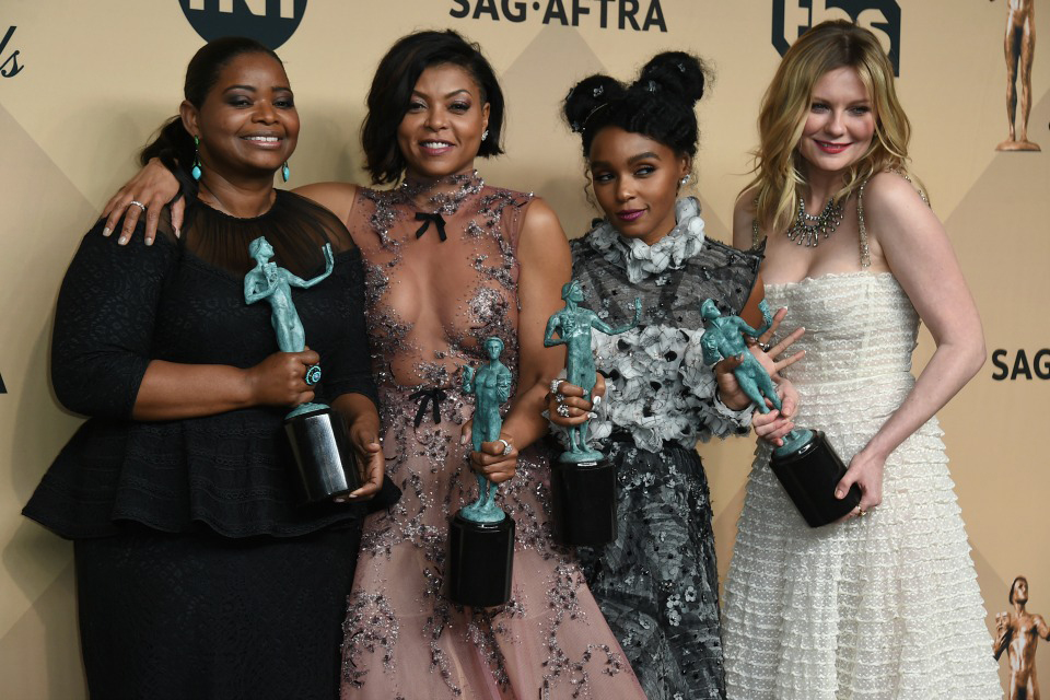 "Octavia Spencer, from left, Taraji P. Henson, Janelle Monae, and Kirsten Dunst pose in the press room with the award for outstanding performance by a cast in a motion picture for ""Hidden Figures"" at the 23rd annual Screen Actors Guild Awards at the Shrine Auditorium & Expo Hall on Sunday, Jan. 29, 2017, in Los Angeles. (Photo by Jordan Strauss/Invision/AP)"
