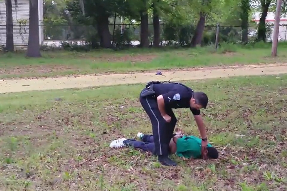 Charleston police officer Michael Slager checks Walter Scott for pulse after the officer shot him five times in the back. (Video still)