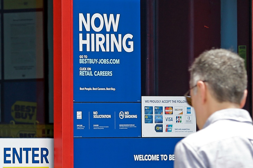 "In this Monday, May 22, 2017, photo, a ""Now Hiring"" sign welcomes a customer entering a Best Buy store in Hialeah, Fla. U.S. employers added a robust 222,000 jobs in June, the most in four months, a reassuring sign that businesses may be confident enough to keep hiring despite a slow-growing economy. (AP Photo/Alan Diaz)"