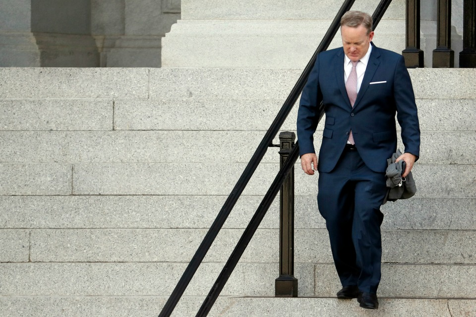 Former White House press secretary Sean Spicer walks down the steps of the Eisenhower Executive Office Building towards the White House, Friday, July 21, 2017, in Washington.