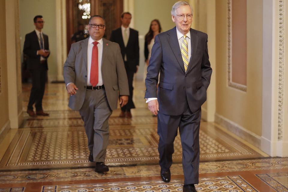 Senate Majority Leader Mitch McConnell of Ky. walks to his office on Capitol Hill in Washington, July 13, 2017. Republicans' latest health care plan would create winners and losers among Americans up and down the income ladder, and across age groups. (AP Photo/Pablo Martinez Monsivais, File)