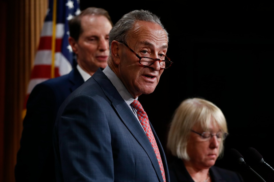 Senate Minority Leader Chuck Schumer, D-N.Y., center, joined by Sen. Patty Murray, D-Wash., right, and Sen. Ron Wyden, D-Ore., left, speaks during a new conference on Capitol Hill in Washington, Monday, June 26, 2017,