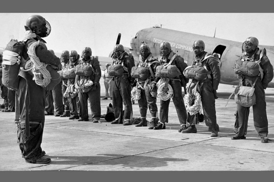 The 555th Parachute Infantry Battalion waiting for a routine equipment check. (Photo courtesy of US Army Center of Military History