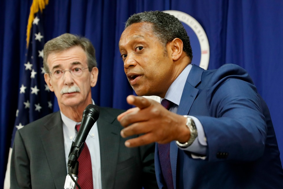 District of Columbia Attorney General Karl Racine, right, accompanied by Maryland Attorney General Brian Frosh, speaks during a news conference in Washington, Monday, June 12, 2017.
