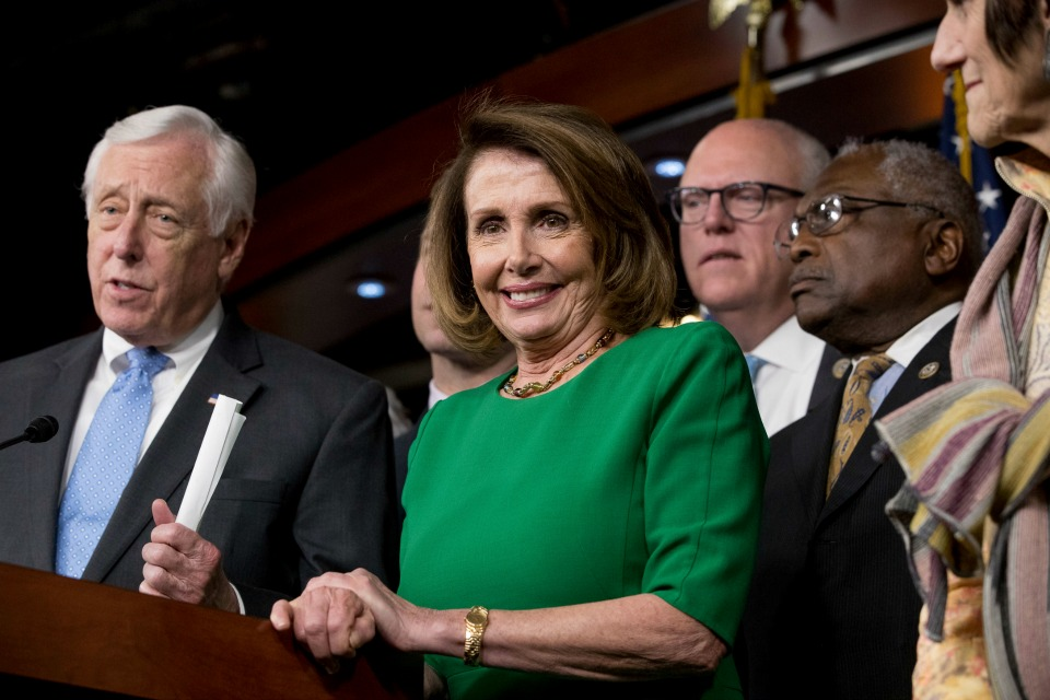 House Minority Leader Nancy Pelosi of Calif., accompanied by Democratic Whip Steny Hoyer, D-Md., Rep. Joseph Crowley, D-N.Y., and Jim Clyburn, D-S.C.