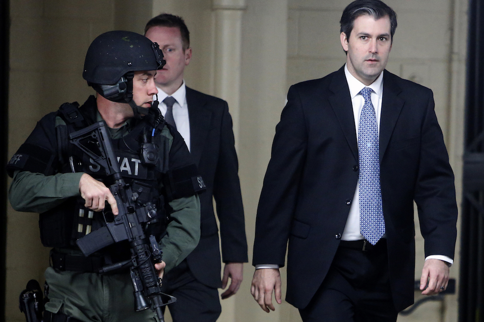 Michael Slager, right, walks from the Charleston County Courthouse under the protection from the Charleston County Sheriff's Department after a mistrial was declared for his trial in Charleston, S.C., Monday, Dec. 5, 2016, Slager, a former South Carolina police officer wants a judge to throw out the key piece of evidence against him in the 2015 shooting death of unarmed black motorist Walter Scott: a bystander's cellphone video of the killing that was viewed millions of times. That's one of the things Slager will be seeking to do when he's in court Friday, March 17, 2017, for a hearing ahead of his federal civil rights trial. (AP Photo/Mic Smith, File)