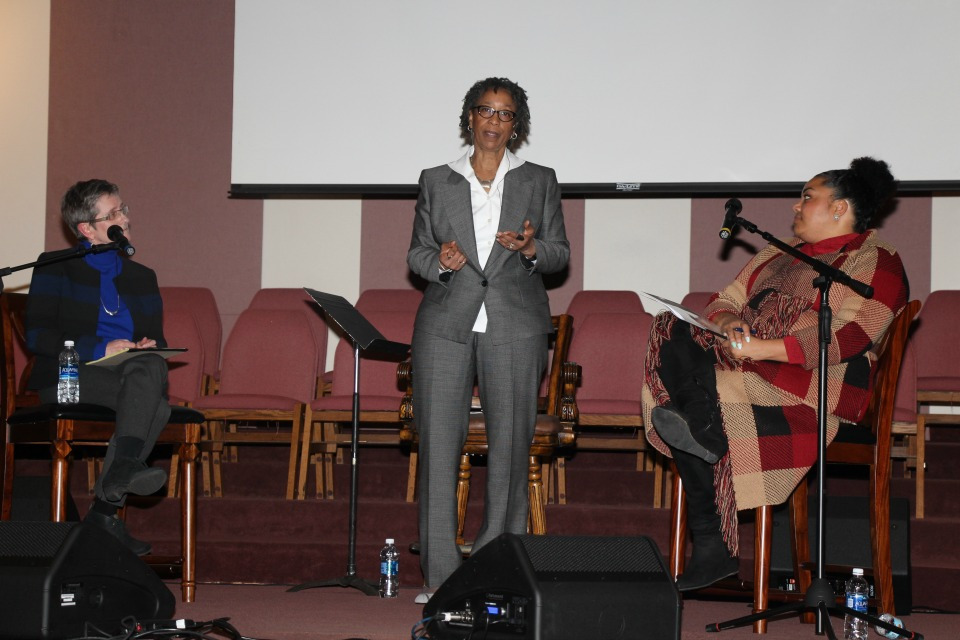 PPS Zone 4 candidates Rita Moore, left, and Jamila Singleton Munson, right, on stage at Maranatha Church in NE Portland for Black Voices Candidate's Forum. Moderator Dr. Velma Johnson, president of Teachable Moments Consulting, LLC, stands center. (Photo: Lori Martin)