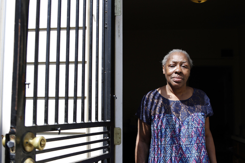 Gladys Harris stands in her doorway in Milwaukee, Monday, April 24, 2017. She was unable to vote in the November presidential election because she had lost her driver's license a few days before and thought one of the many other cards she had with her would work. She was given a provisional ballot but was unable to return with a proper ID in time. It was the first presidential election to be held under a new state law requiring a driver's license, state ID, passport, military ID, naturalization papers or tribal ID to vote. (AP Photo/Carrie Antlfinger)