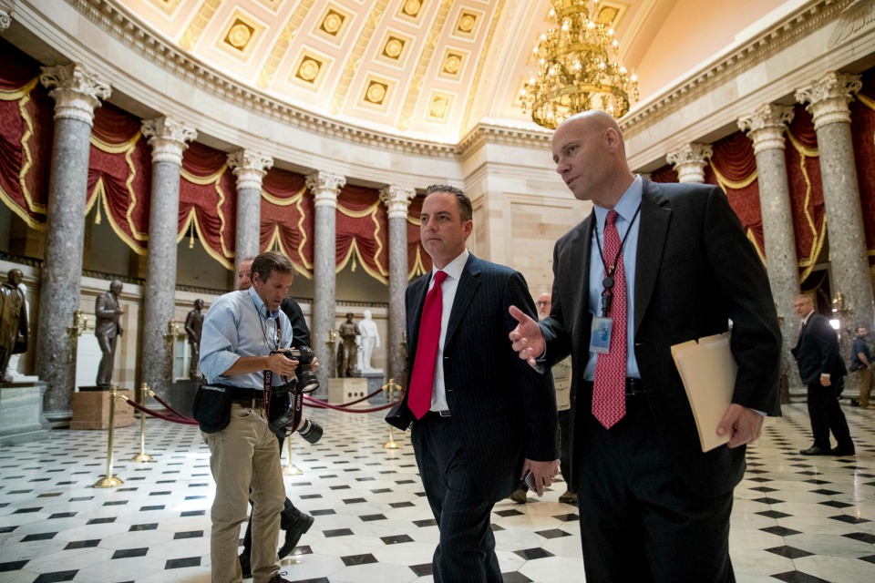 White House Chief of Staff Reince Priebus, center, walks near the House Chamber on Capitol Hill in Washington, Thursday, May 4, 2017.