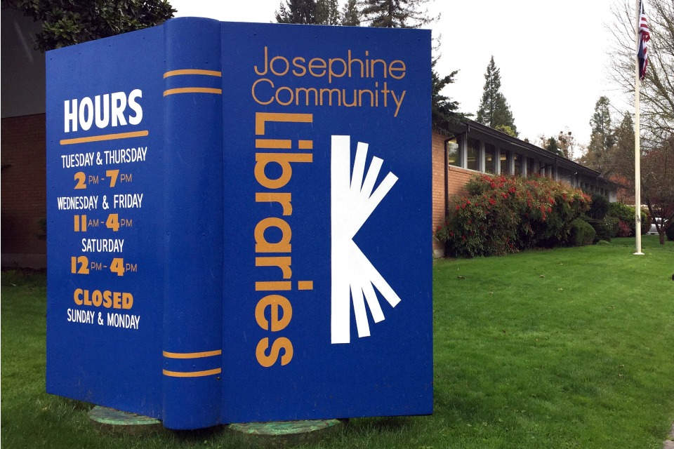 In this April 7, 2017, photo, a large display stands in the lawn of the main Josephine County library branch in Grants Pass, Ore.