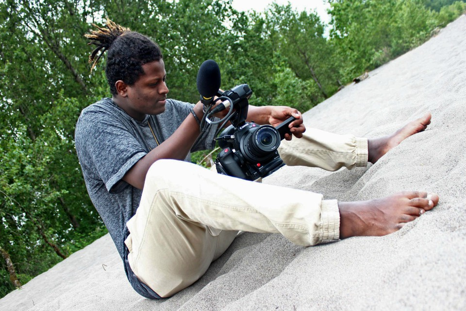 Program participant Mohamed settles in for a low angle during a Outside the Frame workshop. (Courtesy of Outside the Frame)