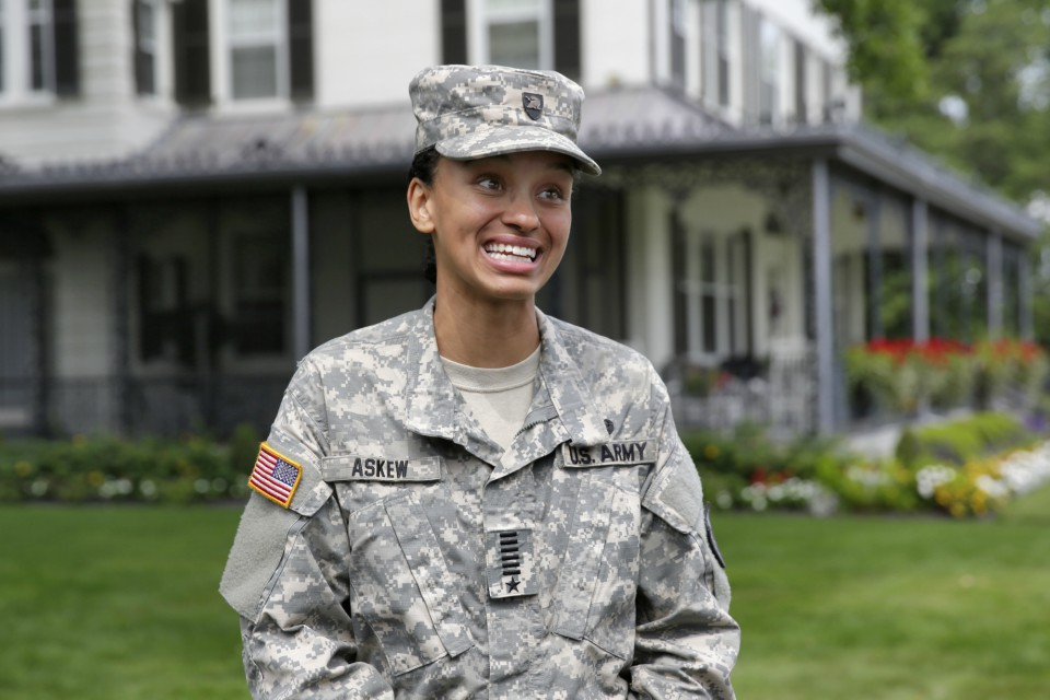 In this Monday, Aug. 14, 2017, file photo, Cadet Simone Askew, of Fairfax, Va., who has been selected first captain of the U.S. Military Academy Corps of Cadets for the upcoming academic year, answers questions during a news conference, in West Point, NY.