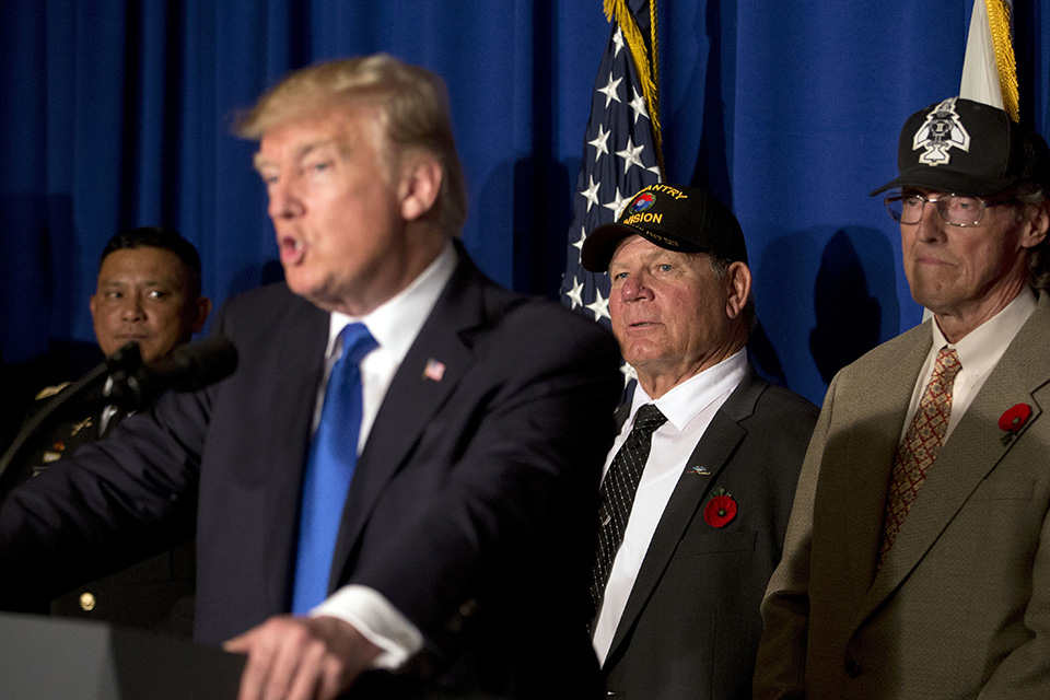American military veterans listen to U.S. President Donald Trump at an event to sign a proclamation honoring veterans at the Hyatt Regency Danang Resort in Danang, Vietnam, Friday, Nov. 10, 2017. Trump is in Vietnam to attend the Asia-Pacific Economic Cooperation (APEC) Summit. (AP Photo/Mark Schiefelbein)