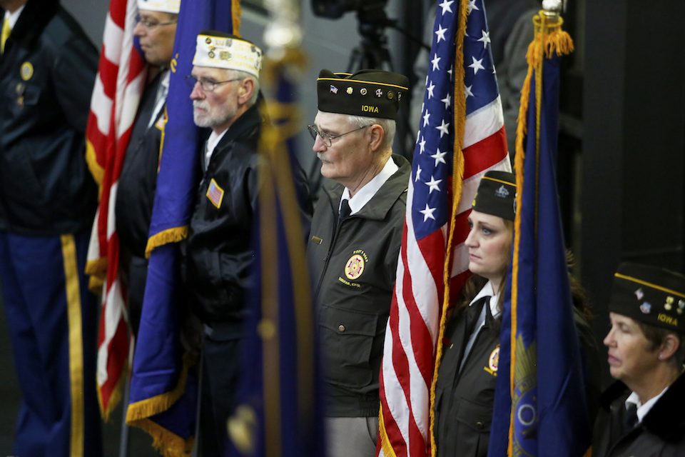 U.S. military veterans attend the Veterans Day ceremony held at the Mystique Community Ice Center in Dubuque, Iowa, Saturday, Nov. 11, 2017. (Eileen Meslar/Telegraph Herald via AP)