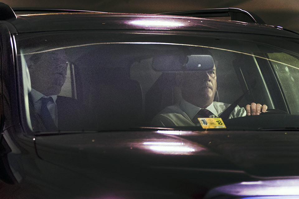 Former Trump Campaign Chairman Paul Manafort, left, leaves his home in Alexandria, Va., Monday, Oct. 30, 2017, in Washington. Manafort, and a former business associate, Rick Gates, have been told to surrender to federal authorities Monday, according to reports and a person familiar with the matter. (AP Photo/Andrew Harnik)