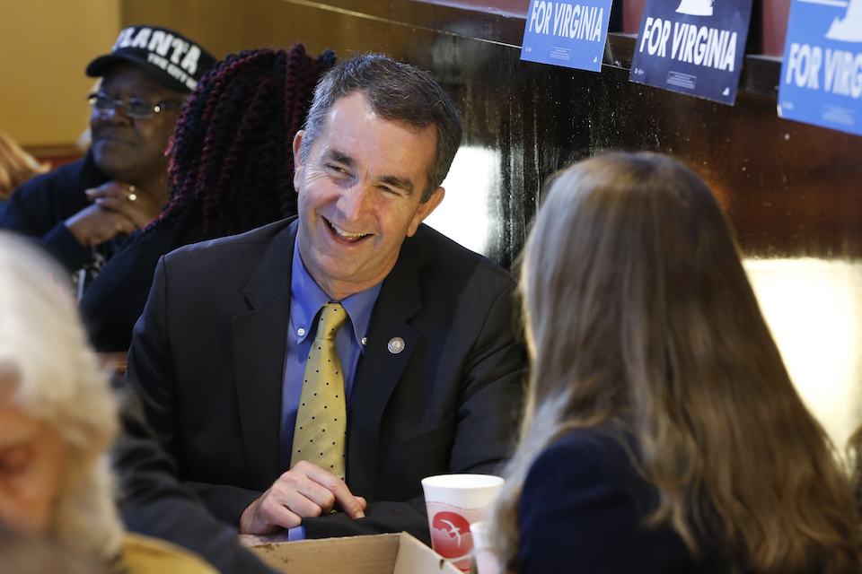 Democratic gubernatorial candidate Ralph Northam speaks with voters at a restaurant in Berryville, Va. Oct. 25, 2017. Virginia's gubernatorial election stands as a test for the anti-Donald Trump resistance, and whether it can energize voters and donors for the less glamorous races featuring traditional Democratic politicians. The Nov. 7 contest pits Lt. Gov. Ralph Northam, a physician, Army veteran and former state senator, against Ed Gillespie, onetime aide to President George W. Bush and former head of the Republican Party. (AP Photo/Steve Helber, File)