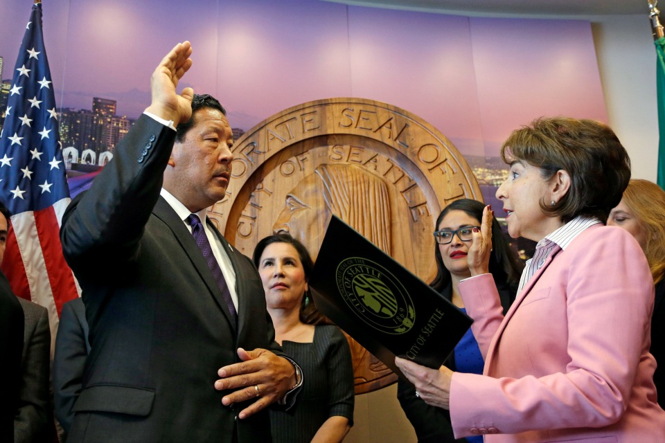 Seattle City Council President Bruce Harrell, left, is sworn in as Seattle mayor by City Clerk Monica Martinez Simmons, Wednesday, Sept. 13, 2017, in Seattle.