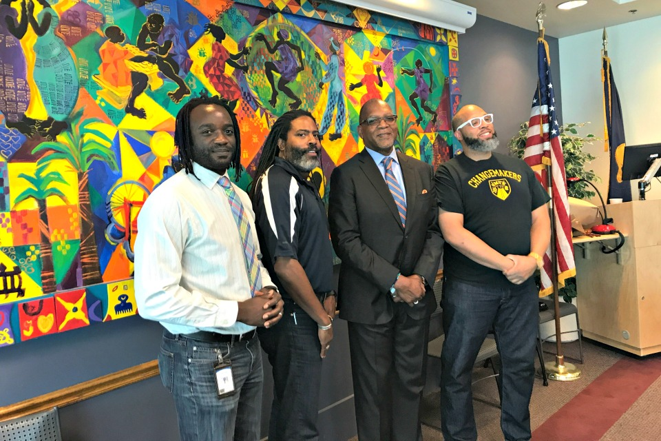 Black Male Achievement Director C.J. Robbins, BMA steering committee member Erious Johnson, Kevin Modica and BMA steering committee member Justice Rajee.