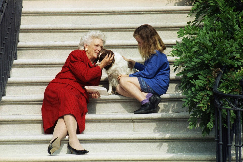 In this Sept. 13, 1991, file photo, first lady Barbara Bush, her granddaughter Barbara, and Millie wait on the steps of the White House for U.S. President George H.W. Bush to return from his check-up at Bethesda Naval Hospital in Washington. A family spokesman said Tuesday, April 17, 2018, that former first lady Barbara Bush has died at the age of 92. (AP Photo/Barry Thumma, File )