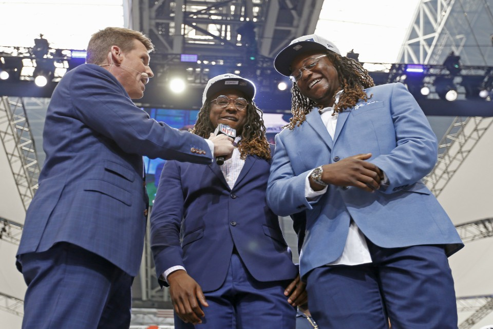 NFL Network's Scott Hanson, left, talks with Seattle Seahawks cornerback Shaquill Griffin, center, and Shaquem Griffin on stage during the NFL football draft in Arlington, Texas, Saturday, April 28, 2018. The Seahawks selected Shaquem in the fourth round. (Jae S. Lee/The Dallas Morning News via AP)
