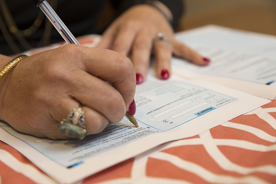 hands of woman filling out census form