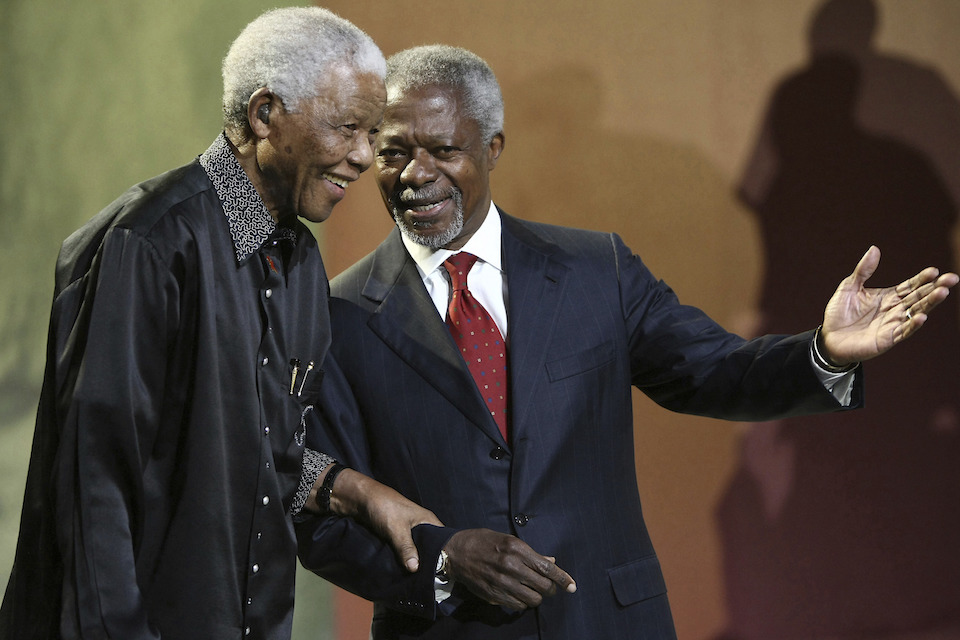 Nelson Mandela and former United Nations Secretary General Kofi Annan arrive together at the 5th Nelson Mandela Annual Lecture, held at the Linder Auditorium in Johannesburg, South Africa, Sunday, July 22, 2007. Annan, one of the world's most celebrated diplomats and a charismatic symbol of the United Nations who rose through its ranks to become the first black African secretary-general, has died. He was 80. (AP Photo, File)