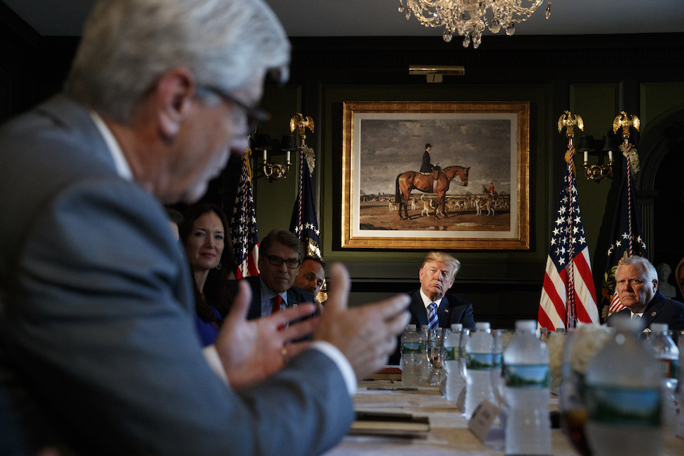 President Donald Trump looks to Mississippi Gov. Phil Bryant, left, as he speaks during a meeting with state leaders about prison reform, Thursday, Aug. 9, 2018, at Trump National Golf Club in Bedminster, N.J. Also seated at the table from left, are Brooke Rollins, Assistant to the President for Strategic Initiatives, Secretary of Energy Rick Perry, Kentucky Gov. Matt Bevin, and Georgia Governor Nathan Deal, right. (AP Photo/Carolyn Kaster)