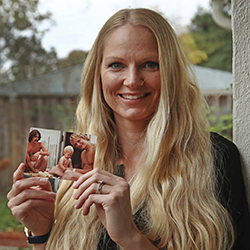 In this Wednesday, Dec. 5, 2018, photo, Diana Sauer holds a family photograph of her father, Warren Deboer, holding her as a baby, and his best friend Russell Anderson, left, in Concord, Calif. In the aftermath of Northern California's catastrophic wildfire, social media sites filled with posts from people trying to find loved ones in and near the town of Paradise. A group of women scattered across the U.S. knew they could help. The women volunteer as